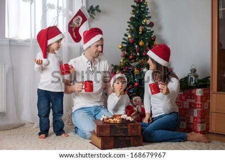Happy family having breakfast on Christmas - stock photo