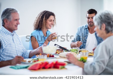 Happy family having breakfast together at home - stock photo