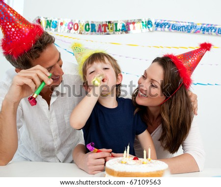 Happy family having fun during a birthday in the kitchen - stock photo