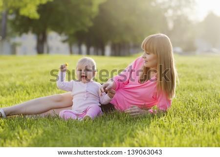 Happy family having fun in summer park - stock photo