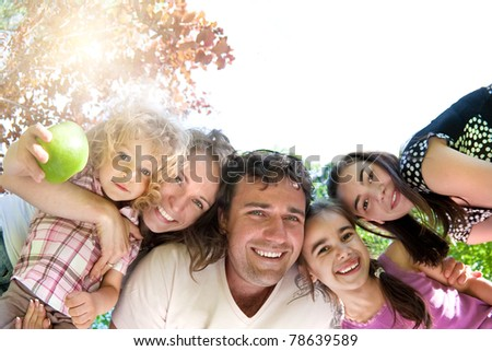 Happy family having fun in summer park - stock photo