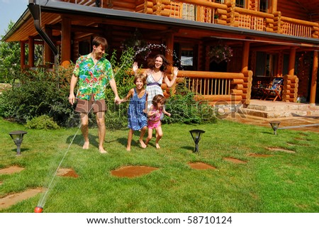 Happy family having fun in the garden - stock photo