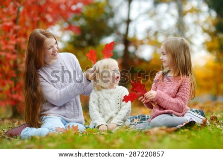 Happy family having fun on beautiful autumn day - stock photo