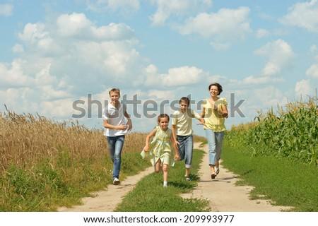 Happy family having fun outdoors against the sky - stock photo