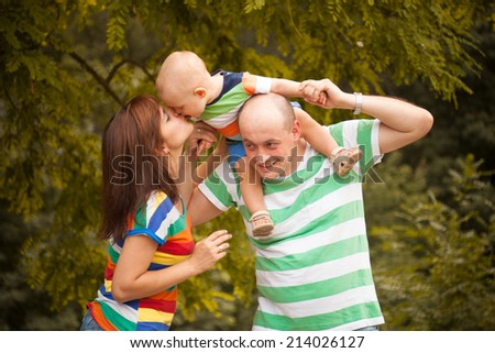 happy family having fun outdoors on a summer day - stock photo