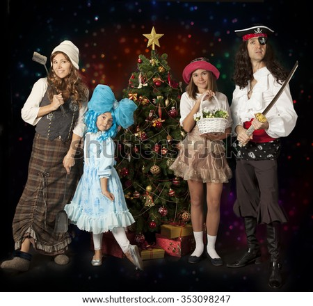 Happy family having fun with carnival costumes. Family and celebrations concept.