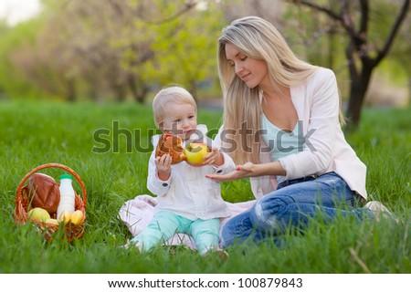 Happy family having picnic in the spring park - stock photo