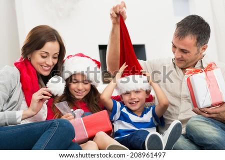 Happy Family Holding Christmas Gift - stock photo