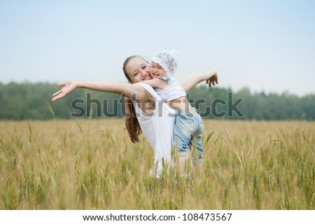 Happy family in a meadow - stock photo