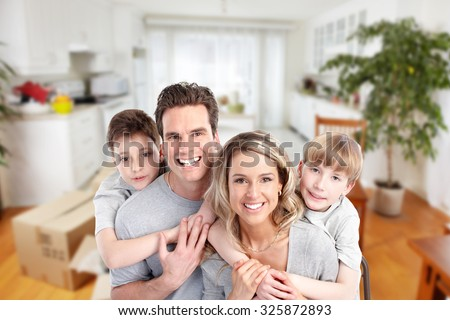 Happy family in a new house. Real estate and moving background. - stock photo