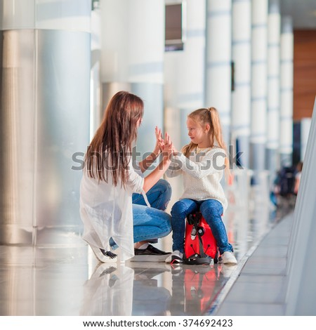 Happy family in airport have fun waiting for boarding - stock photo