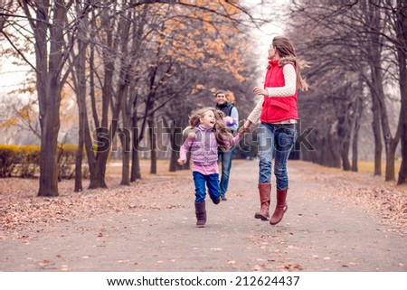 Happy family in autumn park. Autumn walk, November - stock photo