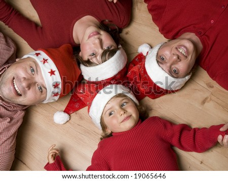 Happy family in Christmas time - stock photo