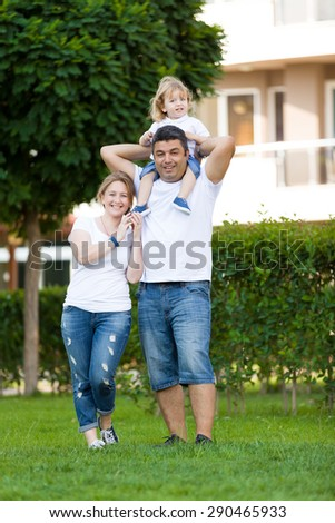 Happy family in garden. - stock photo