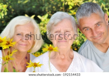 Happy family in garden. MANY OTHER PHOTOS FROM THIS SERIES IN MY PORTFOLIO. - stock photo