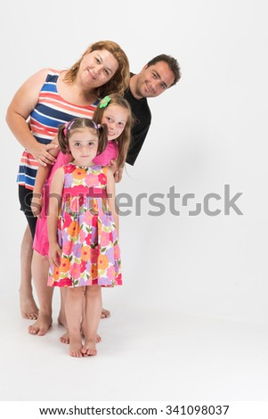 Happy family in line leaning towards right side and smiling - stock photo
