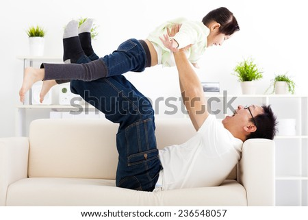 happy family in living room - stock photo