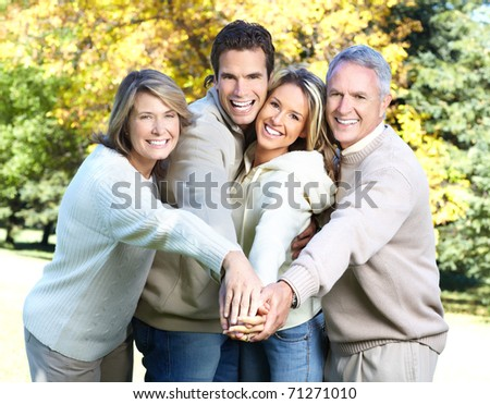 Happy family in park. Father, mother, son and daughter - stock photo