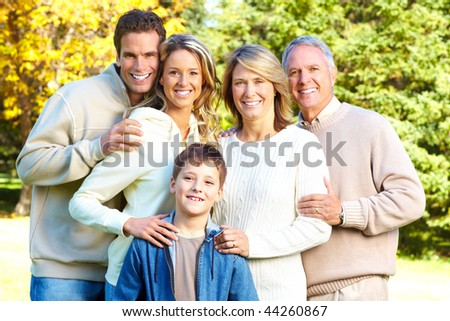 Happy family in park. Grandfather, grandmother, father, mother and son - stock photo