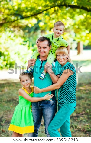 Happy family in the park. Happiness. - stock photo