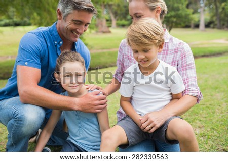 Happy family in the park on a sunny day - stock photo