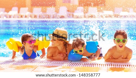 Happy family in the pool, having fun in the water, mother with three kids enjoying aqua park, beach resort, summer holidays, vacation concept  - stock photo