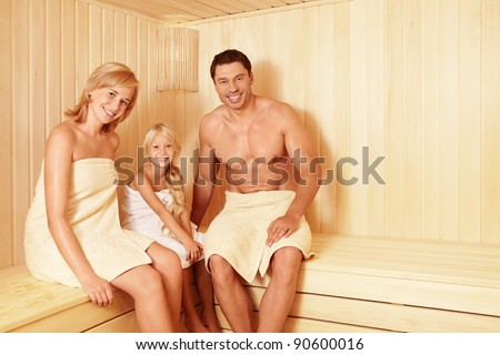 Happy family in the sauna - stock photo