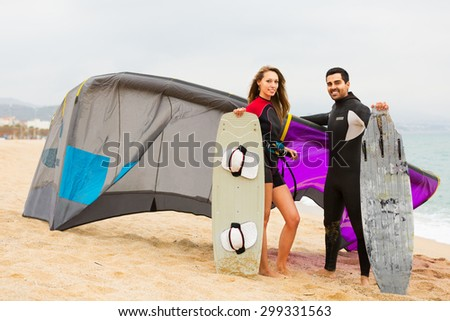 Happy family in the wetsuits with surf boards  - stock photo