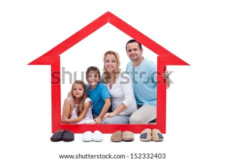 Happy family in their home concept - with slippers aligned in front - stock photo