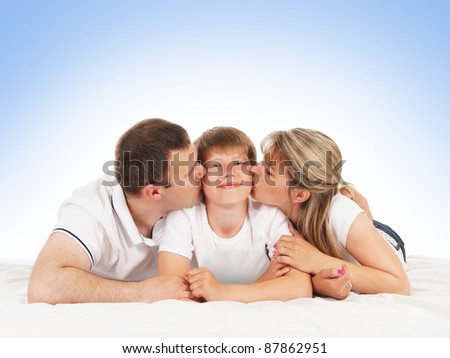 Happy family isolated over blue background - stock photo