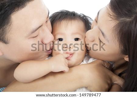 Happy  family kissing the baby - stock photo