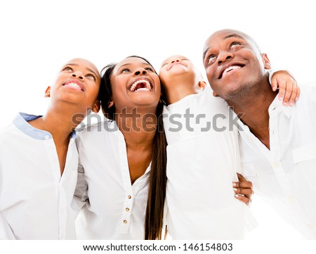 Happy family looking up and smiling - isolated over white background  - stock photo