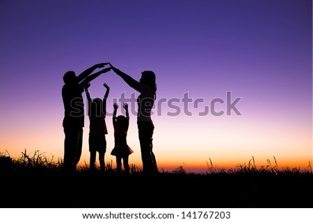happy family making the home sign on the hill - stock photo