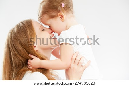 happy family mother and child baby daughter hugging and kissing - stock photo