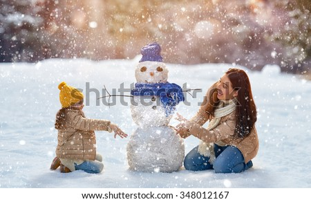 Happy family! Mother and child girl on a winter walk in nature. - stock photo