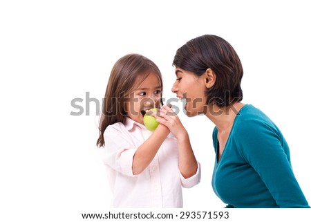 happy family, mother and daughter with raw organic green apple, concept of healthy food - stock photo