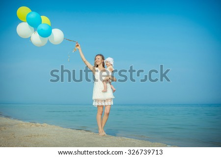 Happy family. Mother and her daughter having fun on the beach. Positive human emotions, feelings, emotions. - stock photo