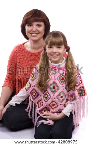 Happy family. Mother and little daughter are smiling . Woman and girl are hugging and posing happily on white background - stock photo