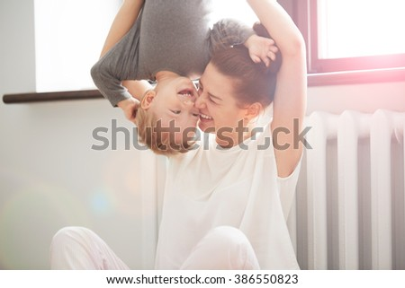 Happy family. Mother and son playing and smiling. Little boy having fun with his mother at home - stock photo