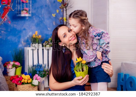 happy family. mother daughter in the room. daughter kissing mother. Mother's Day. March 8,   - stock photo