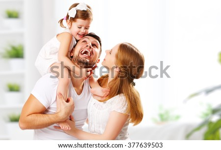 happy family mother, father,  child daughter at home - stock photo