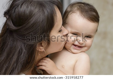 Happy family mother kissing laughing baby. Mother's Love  - stock photo