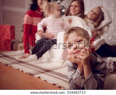 Happy family near Christmas tree - stock photo