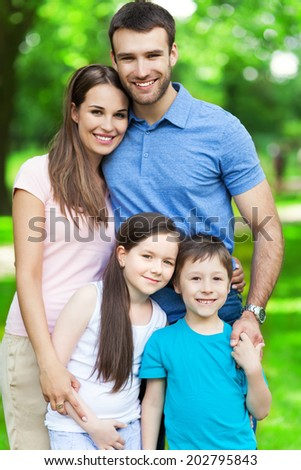 Happy family of four - stock photo
