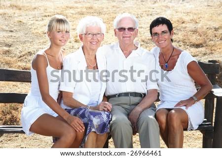 happy family of four - bright lifestyle portrait - stock photo