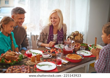 Happy family of four celebrating Thanksgiving day - stock photo