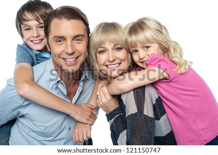 Happy family of four members posing together isolated on white background - stock photo