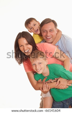 happy family of four on a light background - stock photo