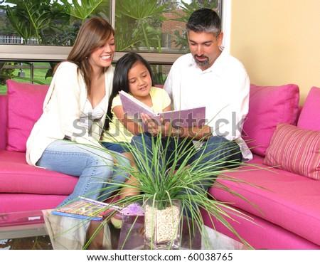 Happy family of the house on a sofa - stock photo