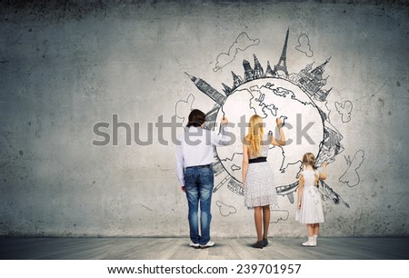 Happy family of three and sketches at background - stock photo